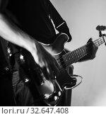Купить «Electric bass guitar player, live music theme», фото № 32647408, снято 11 декабря 2016 г. (c) EugeneSergeev / Фотобанк Лори