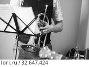 Купить «Flugelhorn in trumpeter hands. Retro stylized black and white», фото № 32647424, снято 18 мая 2019 г. (c) EugeneSergeev / Фотобанк Лори
