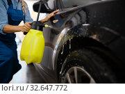 Купить «Female washer with wax spray, car wash service», фото № 32647772, снято 3 октября 2019 г. (c) Tryapitsyn Sergiy / Фотобанк Лори