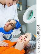 Woman client examining result of procedures. Стоковое фото, фотограф Яков Филимонов / Фотобанк Лори