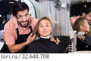 Купить «professional male hairdresser with visitor», фото № 32648708, снято 24 февраля 2020 г. (c) Яков Филимонов / Фотобанк Лори