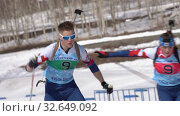 Купить «Saint Petersburg team sportsman biathletes Zaytsev Aleksander and Yashunkina Yuliya skiing snow ski track relay race Junior biathlon competitions East of Cup», видеоролик № 32649092, снято 14 апреля 2019 г. (c) А. А. Пирагис / Фотобанк Лори