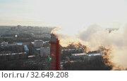 Купить «Air pollution problem in the city - a smoke from industrial pipe pollutes the air in the city», видеоролик № 32649208, снято 20 февраля 2020 г. (c) Константин Шишкин / Фотобанк Лори