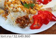 Алу Пядж Чаначур с рисом и пикули из манго. Стоковое фото, фотограф Марина Володько / Фотобанк Лори