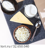 Купить «Food is a source of calcium, magnesium, protein, fats, carbohydrates, balanced diet. Dairy products on the table: cottage cheese, sour cream, milk, cheese, contain casein, albumin, globulin, free lactose», фото № 32650040, снято 14 декабря 2019 г. (c) Светлана Евграфова / Фотобанк Лори