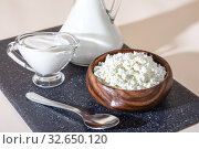 Купить «Food is a source of calcium, magnesium, protein, fats, carbohydrates, balanced diet. Dairy products for breakfast: cottage cheese, sour cream, milk, contain casein, albumin, globulin, free lactose», фото № 32650120, снято 14 декабря 2019 г. (c) Светлана Евграфова / Фотобанк Лори