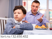 Upset father and offended son arguing in domestic interior. Стоковое фото, фотограф Яков Филимонов / Фотобанк Лори