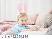 Купить «beautiful little boy in rabbit ears with easter eggs on the couch», фото № 32650896, снято 13 декабря 2019 г. (c) Майя Крученкова / Фотобанк Лори