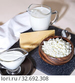 Food is a source of calcium, magnesium, protein, fats, carbohydrates, balanced diet. Dairy products on the table: cottage cheese, sour cream, milk, cheese, contain casein, albumin, globulin, free lactose. Стоковое фото, фотограф Светлана Евграфова / Фотобанк Лори