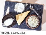 Купить «Food is a source of calcium, magnesium, protein, fats, carbohydrates, balanced diet. Dairy products on the table: cottage cheese, sour cream, milk, cheese, contain casein, albumin, globulin, free lactose», фото № 32692312, снято 14 декабря 2019 г. (c) Светлана Евграфова / Фотобанк Лори