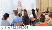 Купить «Students listening to lecture of female teacher», фото № 32696064, снято 23 февраля 2020 г. (c) Яков Филимонов / Фотобанк Лори
