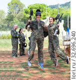 Купить «cheerful young man and woman in full paintball gear having fun after match», фото № 32696240, снято 22 сентября 2018 г. (c) Яков Филимонов / Фотобанк Лори