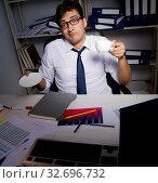 Купить «Man businessman working late hours in the office», фото № 32696732, снято 3 августа 2017 г. (c) Elnur / Фотобанк Лори