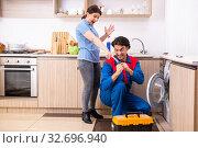 Купить «Young male repairman repairing washing machine», фото № 32696940, снято 7 марта 2019 г. (c) Elnur / Фотобанк Лори