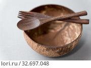 Купить «close up of coconut bowl, wooden spoon and fork», фото № 32697048, снято 3 мая 2019 г. (c) Syda Productions / Фотобанк Лори