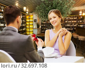 Купить «man making proposal to happy woman at restaurant», фото № 32697108, снято 9 марта 2014 г. (c) Syda Productions / Фотобанк Лори