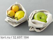Купить «fruits in reusable canvas bags for food shopping», фото № 32697184, снято 3 мая 2019 г. (c) Syda Productions / Фотобанк Лори