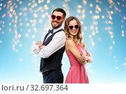 happy couple in heart-shaped sunglasses. Стоковое фото, фотограф Syda Productions / Фотобанк Лори
