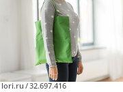 Купить «woman with reusable canvas bag for food shopping», фото № 32697416, снято 3 мая 2019 г. (c) Syda Productions / Фотобанк Лори