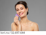 Купить «young woman with sponge applying makeup», фото № 32697644, снято 30 ноября 2019 г. (c) Syda Productions / Фотобанк Лори