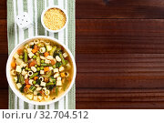 Купить «Fresh homemade vegetable soup made of zucchini, celery, carrot, peas, white beans, green beans, potato, tomato, spinach and ditali soup pasta served in...», фото № 32704512, снято 26 мая 2020 г. (c) easy Fotostock / Фотобанк Лори