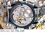 Купить «Watchmaker workshop - open vintage watch on heap of clock spare parts», фото № 32706248, снято 29 января 2020 г. (c) easy Fotostock / Фотобанк Лори
