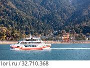 Купить «Ferryboat of JR company comes from the island of Miyajima (Itsukushima) in Hiroshima gulf. It operates from Miyajima-guchi. Japan», фото № 32710368, снято 13 апреля 2013 г. (c) Кекяляйнен Андрей / Фотобанк Лори