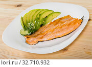 Купить «Image of fried trout fillet served with avocado on the plate», фото № 32710932, снято 27 января 2020 г. (c) Яков Филимонов / Фотобанк Лори