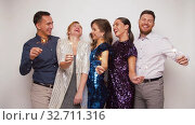 Купить «happy friends with sparklers dancing at party», видеоролик № 32711316, снято 15 декабря 2019 г. (c) Syda Productions / Фотобанк Лори
