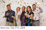 Купить «happy friends under golden confetti at party», видеоролик № 32711324, снято 15 декабря 2019 г. (c) Syda Productions / Фотобанк Лори