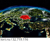 Купить «Romania from space at night on Earth with visible country borders. 3D illustration. Elements of this image furnished by NASA.», фото № 32719116, снято 23 февраля 2020 г. (c) easy Fotostock / Фотобанк Лори