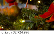 Купить «artificial christmas tree decorated with red bow», видеоролик № 32724996, снято 16 декабря 2019 г. (c) Syda Productions / Фотобанк Лори