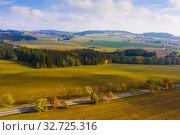 Купить «Autumn countryside landscape with straight road», фото № 32725316, снято 15 октября 2019 г. (c) Яков Филимонов / Фотобанк Лори