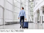 Купить «businessman with travel bag walking along office», фото № 32740840, снято 3 июля 2016 г. (c) Syda Productions / Фотобанк Лори