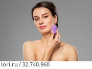 Купить «young woman with sponge applying makeup», фото № 32740960, снято 30 ноября 2019 г. (c) Syda Productions / Фотобанк Лори