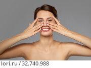 Купить «beautiful young woman touching her face», фото № 32740988, снято 30 ноября 2019 г. (c) Syda Productions / Фотобанк Лори