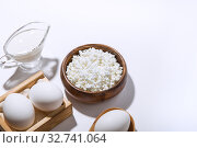 Купить «Food is a source of calcium, magnesium, protein, fats, carbohydrates, balanced diet. Dairy products on the table: cottage cheese, sour cream, milk, chicken egg, contain casein, albumin, globulin, free lactose», фото № 32741064, снято 14 декабря 2019 г. (c) Светлана Евграфова / Фотобанк Лори