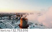 Купить «Industrial theme - smoke coming out of a manufacturing pipe - pollution of the city», видеоролик № 32753016, снято 21 февраля 2020 г. (c) Константин Шишкин / Фотобанк Лори
