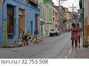 Купить «Cuba, Santiago de Cuba- Cuban family in front of a house in a side street», фото № 32753508, снято 1 августа 2019 г. (c) Caro Photoagency / Фотобанк Лори