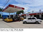 Купить «Cuba, Bayamo- View of a gas station in the city», фото № 32753824, снято 31 июля 2019 г. (c) Caro Photoagency / Фотобанк Лори
