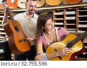 Купить «Guitarist girl playing acoustic guitar», фото № 32755596, снято 11 февраля 2016 г. (c) Татьяна Яцевич / Фотобанк Лори