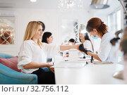 Group of girlfriends, manicure in beauty salon. Стоковое фото, фотограф Tryapitsyn Sergiy / Фотобанк Лори