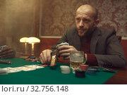 Купить «Poker player with gun plays in casino, risk», фото № 32756148, снято 8 декабря 2019 г. (c) Tryapitsyn Sergiy / Фотобанк Лори