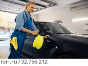Купить «Female washer with wax spray, car wash service», фото № 32756212, снято 3 октября 2019 г. (c) Tryapitsyn Sergiy / Фотобанк Лори