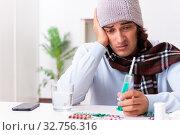Купить «Young man suffering from flu at home», фото № 32756316, снято 24 июля 2019 г. (c) Elnur / Фотобанк Лори