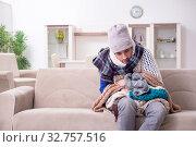 Купить «Young man suffering at home», фото № 32757516, снято 11 апреля 2019 г. (c) Elnur / Фотобанк Лори