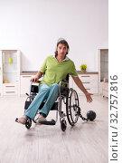 Купить «Young male invalid in wheel-chair suffering at home», фото № 32757816, снято 23 июля 2019 г. (c) Elnur / Фотобанк Лори