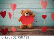 Купить «Teddy bear with red heart on old wooden background. Valentine's day concept», фото № 32758188, снято 14 декабря 2019 г. (c) Майя Крученкова / Фотобанк Лори