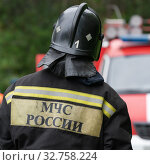 Купить «Back view with emblem Emercom of Russia on uniform rescuers of Ministry of Civil Defence, Emergencies and Disaster Relief of Russian Federation MChS», фото № 32758224, снято 7 августа 2019 г. (c) А. А. Пирагис / Фотобанк Лори