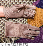 Workshop on sewing gloves - top view of new hand-made gloves on sewn scarves. Стоковое фото, фотограф Zoonar.com/Valery Voennyy / easy Fotostock / Фотобанк Лори